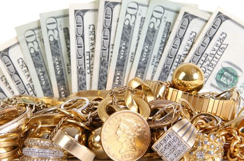 gold in front of cash